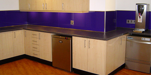 Kitchen with purple splashbacks at Project Grace