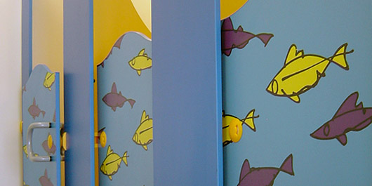 Fish motif on toilet door panels